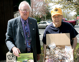 Jim Springer (L) and Lynn Henschen (R) of the Waynedale Lions Club proudly display thier recently collected 608 pairs of eyeglasses.