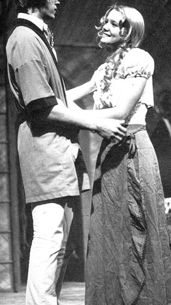 "Melissa (Hunter) Long captivates audience in a play called ""My Three Angels."" Melissa was part of a ten-member cast directed by Donald Goss. In this photo Paul (Geoff Sills) and Marie Louise (Melissa Hunter) meet. Photo taken from Elmhurst High School 1975 Yearbook."