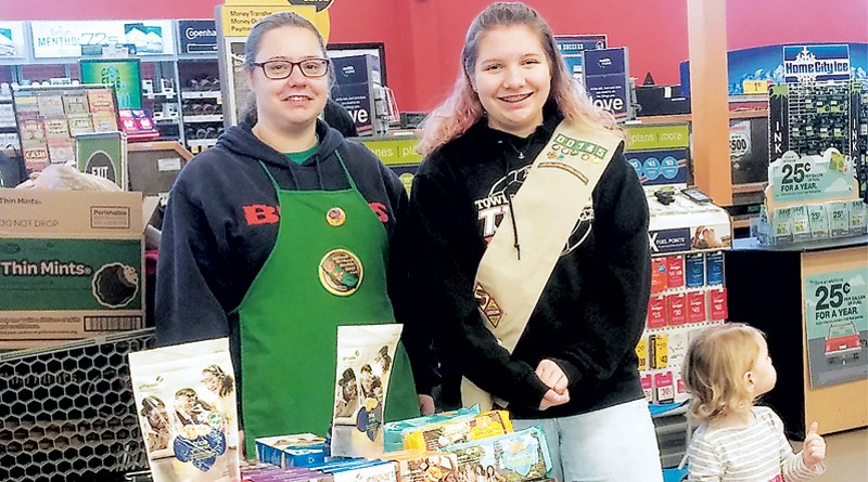 LOCAL GIRL SCOUT TROOP HOPES TO CONTINUE SELLING THE MOST
