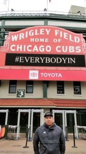 Standing outside the famous Wrigley Field sign.