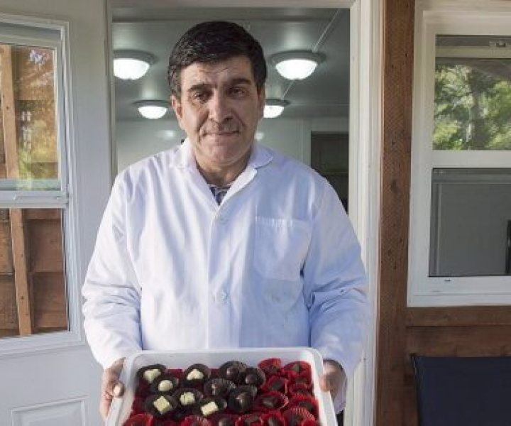 Assam Hadhad, a Syrian refugee who arrived in Canada last year, displays a tray of chocolates at his shop, Peace by Chocolate, in Antigonish, N.S. on September 21, 2016. The one-time Syrian refugee who founded a thriving Nova Scotia chocolate company has announced plans to hire and mentor other refugees. Peace by Chocolate of Antigonish, N.S., has committed to hiring 50 refugees by 2022, and to mentor 10 refugee-run start-ups over the next few years. THE CANADIAN PRESS/Andrew Vaughan