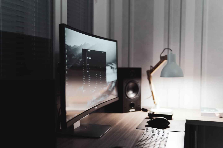 black flat screen computer monitor beside black speaker