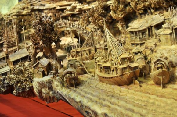 "A giant masterpiece has been recorded as the longest one piece wood carving in the world. And the time it took to get it officially recognised is also almost a record - after the exhibition hall where it is housed revealed it was actually crafted in Fujian province in southeast China nearly 1,000 years ago. Called ""Riverside Scene at Qingming Festival"", it has only now been recognised by the Guinness Book of World Records as the largest single piece wood carving in the world. The work measure 12.286 meters long, and at the highest point is 3.075 meters. It is also 2.401 meters wide. It took artist Zheng Chunhui four years to complete and currently is stored at the Palace Museum in Beijing where it is recognised as a national treasure. A museum spokesman said: ""He was a master craftsman but sadly this is the only piece of his work to have survived. But nevertheless it is a remarkable piece. ""It gives a 3D snapshot of a period in the life of daily life of people of all ranks in the capital city of Bianjing (today's Kaifeng, Henan Province) during Qingming Festival in the Northern Song Dynasty. As such it is also a valuable historical witness, bringing the period to life in a way that a book or scroll never could. ""It's the next best thing to experiencing it in real life, showing rich and poor about their daily business. In fact there are 550 people in the carving."""