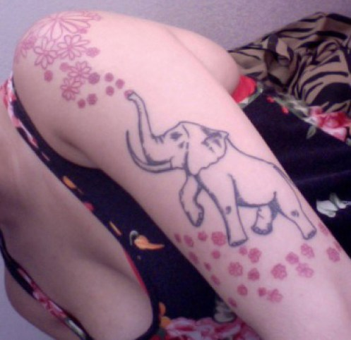 small-daisy-flowers-and-up-trunk-elephant-tattoo1