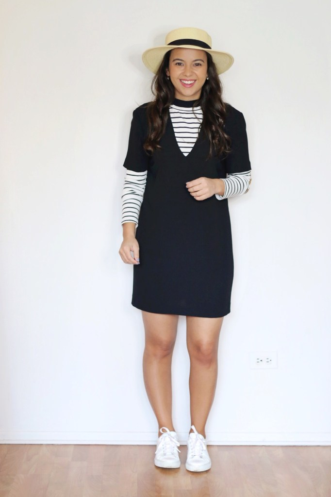 Styling a black dress with sneakers and a striped top