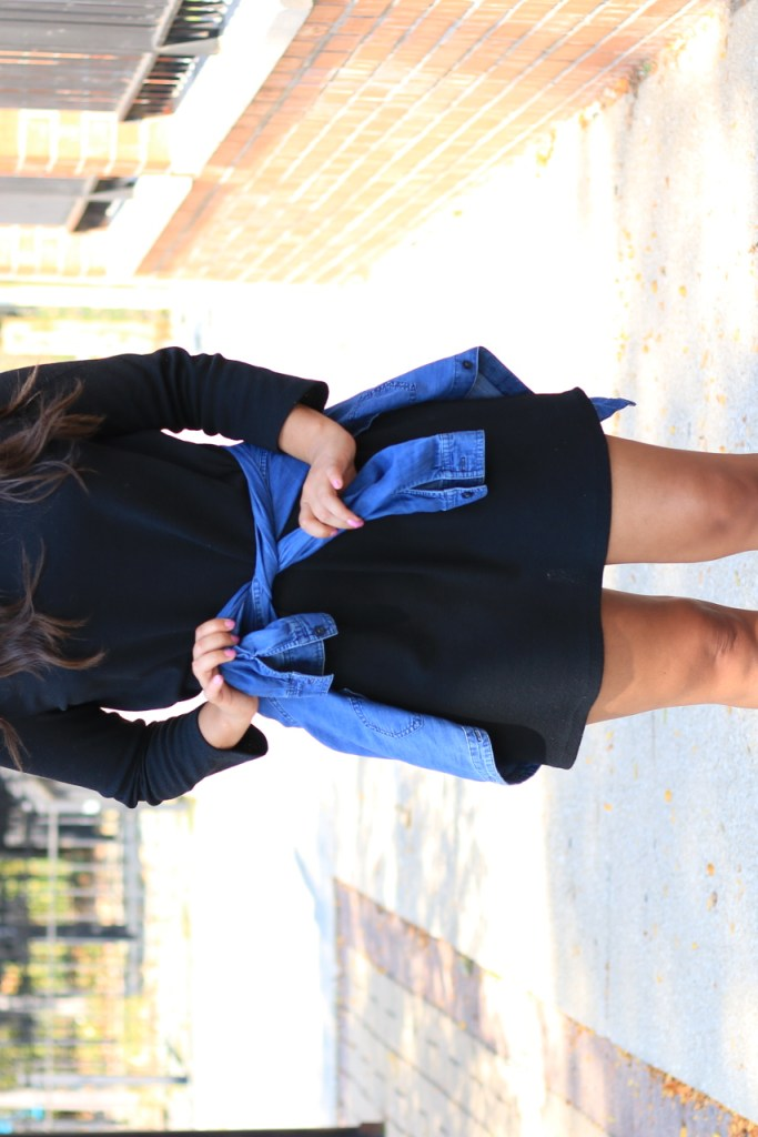 A casual Black Dress styled with sneakers