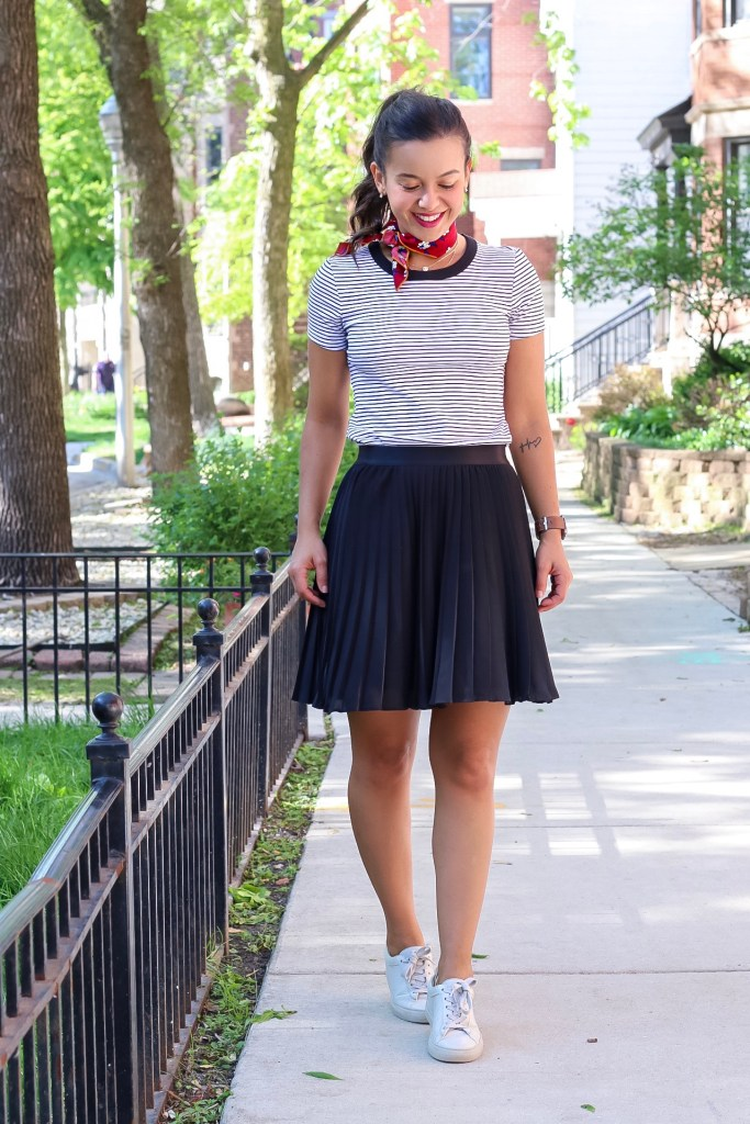 White sneakers outfit with a black skirt and striped top