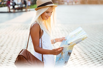 Tourist woman reading map