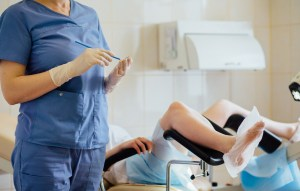 female doctor gynecologist working with patient