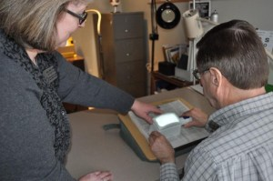 Amy Wurf, Certified Low Vision Therapist, guides a client on how to use a lighted magnifier.