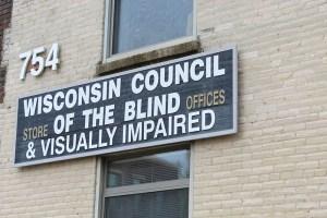 A black and white sign affixed to a brick building.