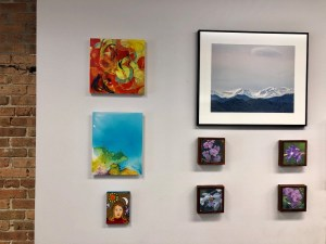 Multiple pieces of art on the wall.