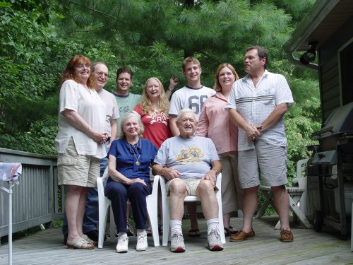 A multi-generational family on a porch.