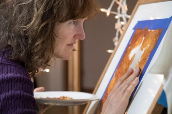 Artist Deb Claire working on art work