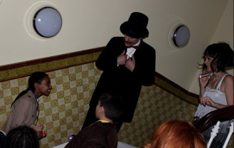 'John Wilson' asks young library agent about clues she has found - Queen's Park Library sleepover, December 2015