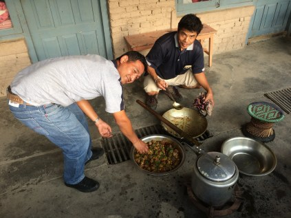 Uddav and Sonam prepare food at Kathmandu Vineyard