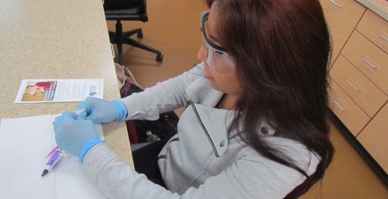 Middle College student working in the lab