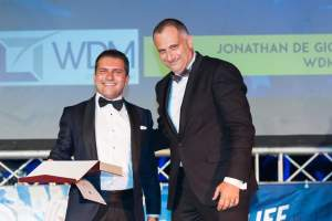Dr. Jonathan De Giovanni being presented the Award for Excellence in Malta's Best Entrepreneur of the Year Awards 2016