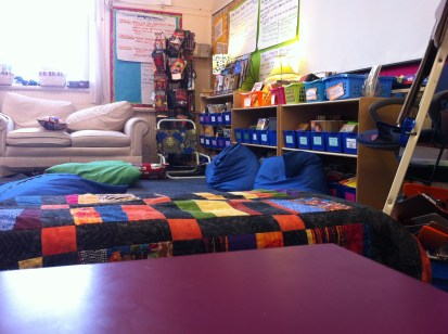 Another view of comfortable furnishing with their classroom library.