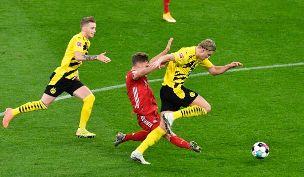 Joshua Kimmich challenges Erling Haaland for the ball