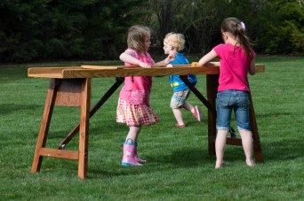 Cousins playing lawn games.