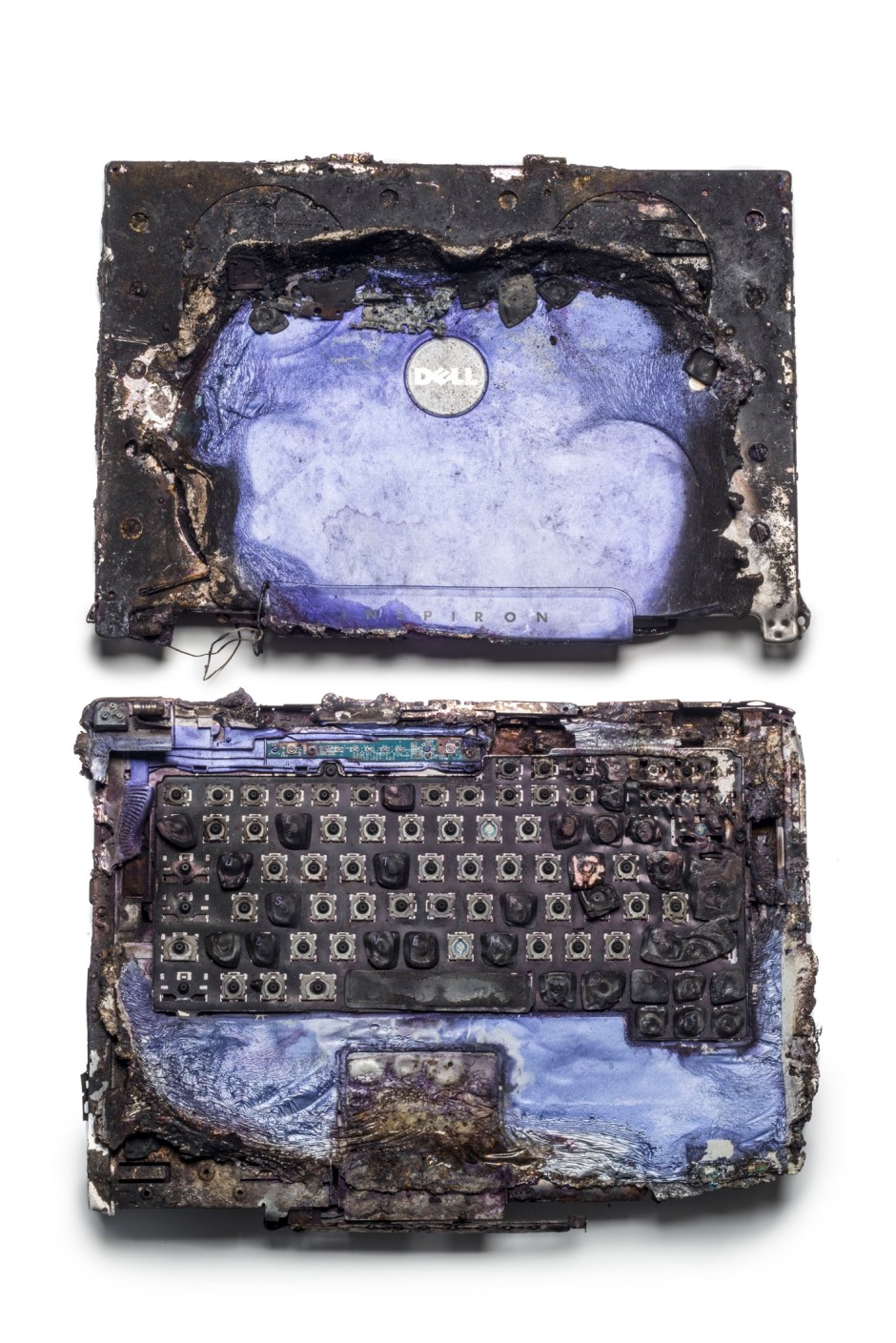 A laptop computer recovered from a car involved in the 2007 Glasgow Airport terrorist attack. Although badly burned, police were able to recover 96% of its data, crucially helping the investigation. © Museum of London / object courtesy the Metropolitan Police's Crime Museum