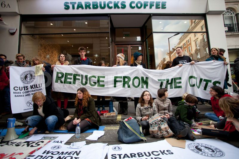 1354999699-starbucks-stores-taken-over-by-uk-uncut-activists_1664912