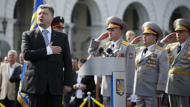 Poroshenko sings a national anthem during the Independence Day military parade, in Kiev
