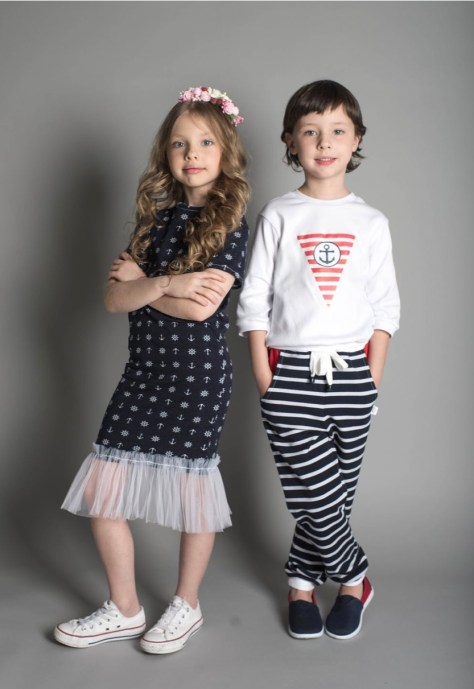 A couple of girls posing for a picture  Description automatically generated with low confidence