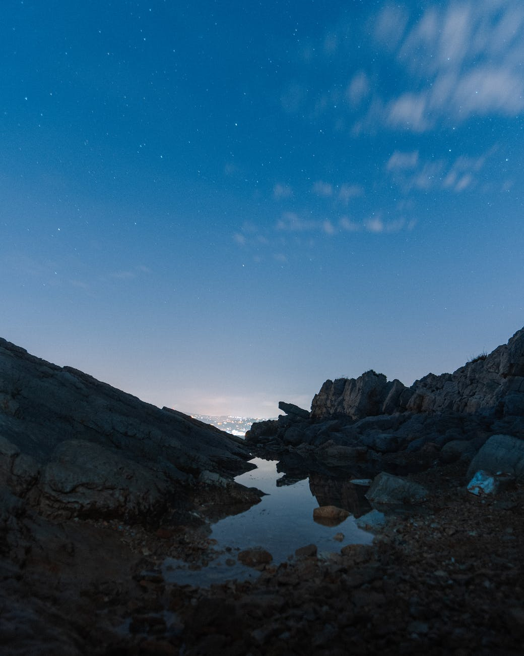 rocky coast with shallow water in evening