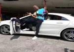 Nigeria Singer, Soft Acquires white Benz Worth millions of Naira (Photo)