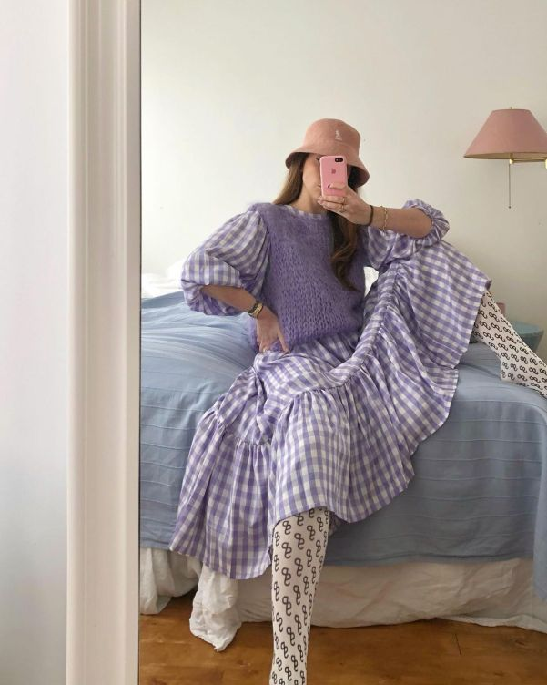 @donossent wearing a gingham dress and printed tights
