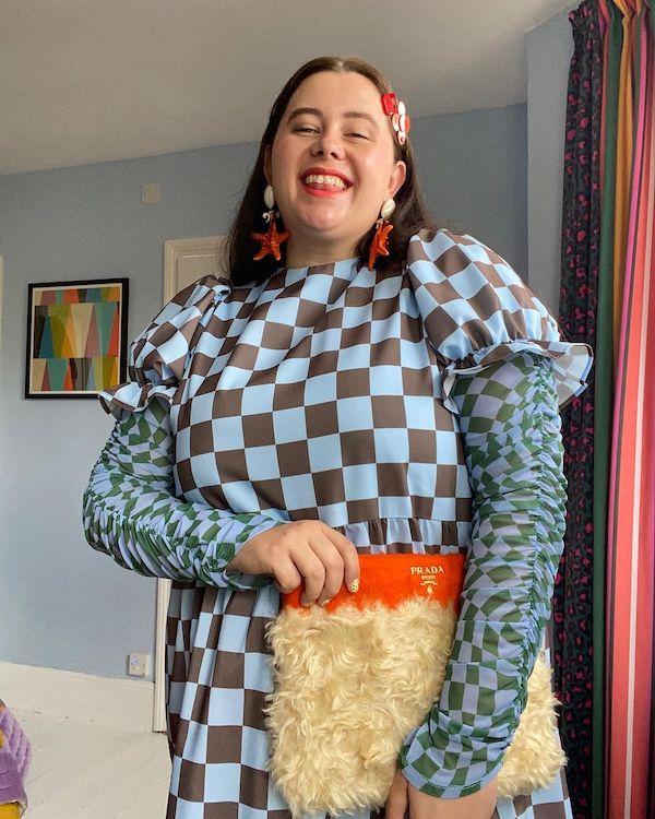 Sara Brown wearing kitsch earrings
