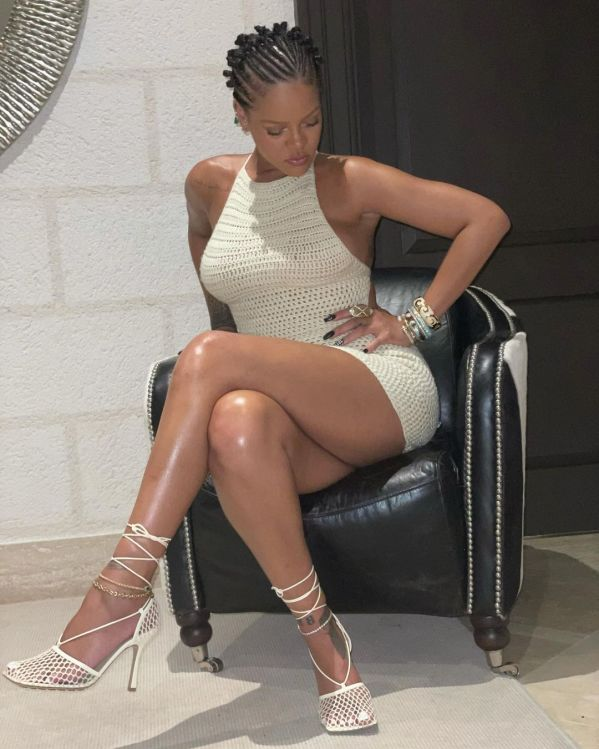 Rihanna wearing a white crochet dress and Bottega Veneta heels