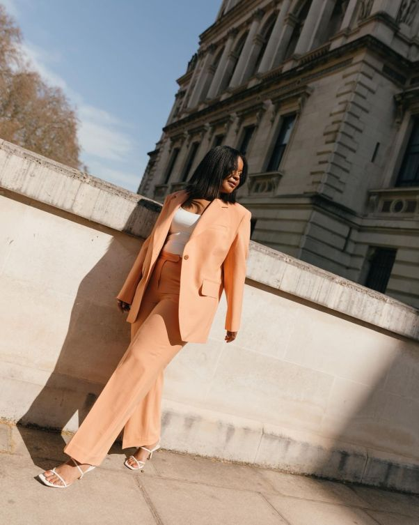 styleidealist wearing peach suit from arket