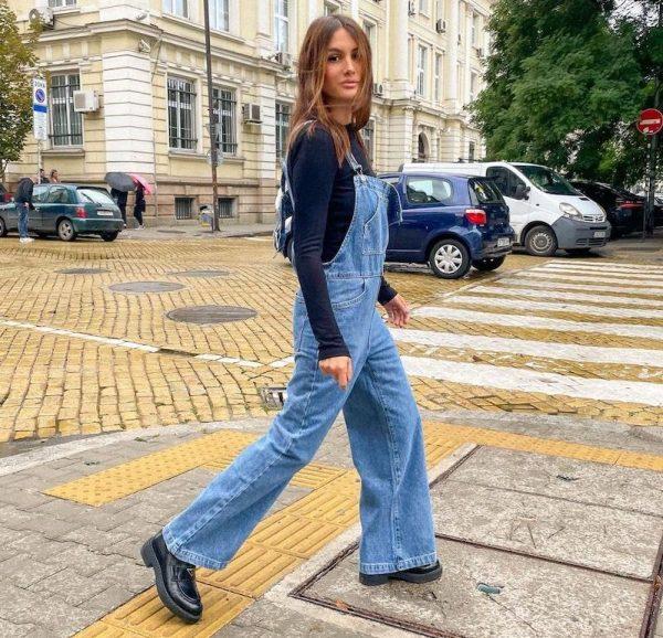 boris lavasekova wearing denim dungarees and prada loafers walking down the street