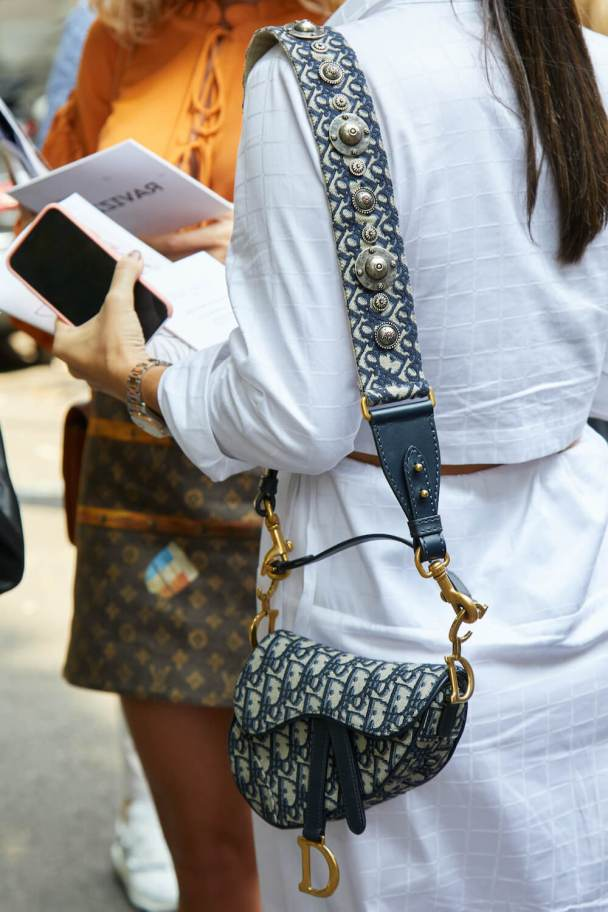 woman wears dior saddle bag