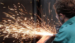 A student grinds a section of metal during the 2014 SkillsUSA Ohio Championships competition in Columbus.