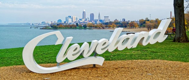 Cleveland sign with the city skyline behind it