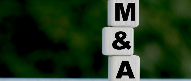 The concept of the word M&A on cubes on a beautiful green background