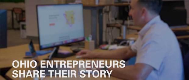 Ohio Entrepreneurs Share their Story - John Romano on a computer