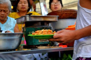 A group of hungry customers waiting to eat one of Yangon's delicious street stall delicacies.