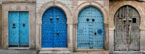 Typical Tunisian door fronts. The tradition of nail-decorated doors was originally introduced to North Africa by the Andalusians of Spain. The Tunisians mastered this art and now these painted doors became one of the characteristics of North African homes.