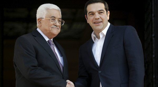 Greek Prime Minister Alexis Tsipras (R) welcomes Palestinian President Mahmoud Abbas at the Maximos Mansion in Athens, Greece, December 21, 2015.  REUTERS/Alkis Konstantinidis