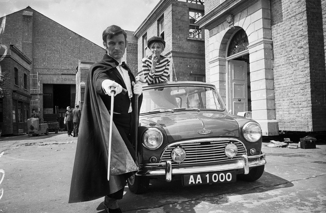 18th May 1966: English actor Gerald Harper as Adam Adamant in the new BBC series 'Adam Adamant Returns', in which he plays a turn of the century swashbuckler who is frozen in ice only to thaw out in time for the swinging sixties. Juliet Harmer plays Georgina Jones, his crime busting sidekick. (Photo by Larry Ellis/Express/Getty Images)