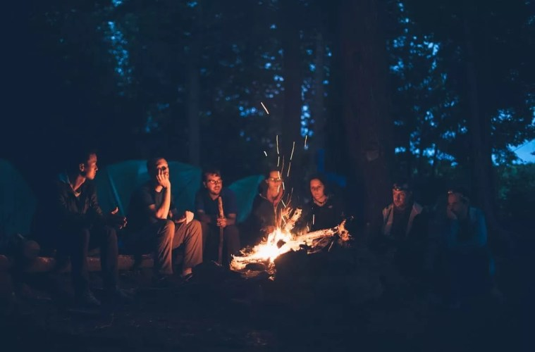 friends camping by the fire