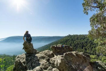 The Sweetest (And Toughest) Hike Near Melbourne // Sugarloaf Peak (VIC), Jaqui Wakefield, rock, sitting, view, mist, valley