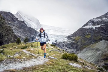 Runner Guy // An Interview With Trail Runner Joe Grant, Photo by Dan Patitucci, mountain pass, distance, snow, fog, hillside