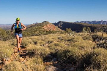 The Hidden Benefits Of Trail Running, photo by Chris Ord, larapinta trail, trail running, woman, fluro, outback