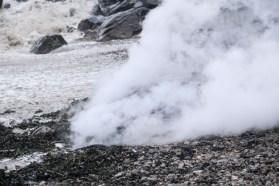 The bonfire billows steam